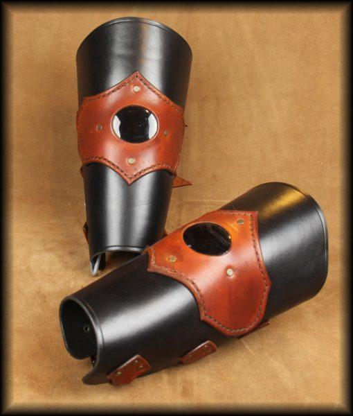 canons de bras agate noire